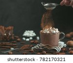 hand sprinkled cinnamon powder... | Shutterstock . vector #782170321