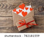card and red hearts in open... | Shutterstock . vector #782181559
