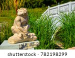 Small photo of A view of an angled monkey statue staring upwards and placed near the side of the bridge wallkway.
