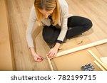 young woman assembling... | Shutterstock . vector #782199715