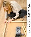 young woman assembling... | Shutterstock . vector #782201344
