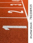 Small photo of All-weather running track. Numbers one, two, three, four.