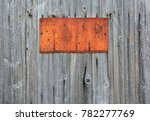 rusty metal sign on wooden wall ... | Shutterstock . vector #782277769