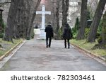visitors on a cemetery in berlin | Shutterstock . vector #782303461
