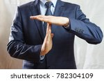 a man in a blue suit shows a... | Shutterstock . vector #782304109