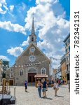 Small photo of Quebec City, Quebec / Canada - 01 August 2015: Tourist are walking on a beautiful cobble stoned square in front of a church in Quebec City.