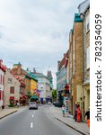 Small photo of Quebec City, Quebec / Canada - 01 August 2015: Quebec City's colourful street with a car and some tourists.