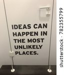 Small photo of Ideas can happen in the most unlikely places - text on the inside of a toilet door.