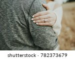 Woman Hugging Man With...