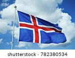Iceland flag against summer sky