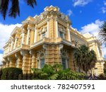 Small photo of Large opulent colonial house / villa with stunning decoration and tropical plants in foreground on Paseo de Montejo boulevard in Merida, beautiful colonial city in Yucatan, Mexico