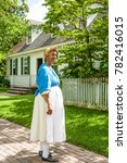 Small photo of Williamsburg, Virginia, USA - 6/21/2009: A woman dressed period clothing as a scullery maid, in Williamsburg.