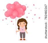 cartoon girl holding pink... | Shutterstock .eps vector #782482267