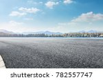 asphalt road and lake with... | Shutterstock . vector #782557747