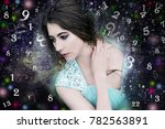 woman and world of numerology | Shutterstock . vector #782563891
