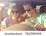 beautiful young couple in car | Shutterstock . vector #782589409