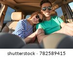beautiful young couple in car | Shutterstock . vector #782589415