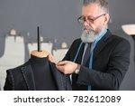 senior man tailoring formal... | Shutterstock . vector #782612089