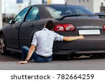 the guy hugs his car | Shutterstock . vector #782664259