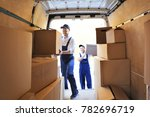 delivery men unloading moving... | Shutterstock . vector #782696719