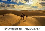 camel ride on the sand dunes of ... | Shutterstock . vector #782705764