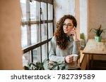 pretty woman talking on phone... | Shutterstock . vector #782739589