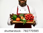 chef holds board with fresh... | Shutterstock . vector #782770585