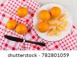 Ripe Tangerines In White Plate...