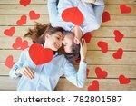 couple lying on the wooden... | Shutterstock . vector #782801587