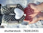 hands holding a snow heart and... | Shutterstock . vector #782813431
