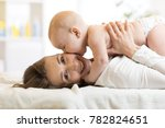 adorable baby kissing his... | Shutterstock . vector #782824651