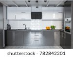 Stock photo modern white and gray kitchenette with ceramic brick tiles 782842201