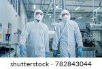 two engineers  scientists in... | Shutterstock . vector #782843044