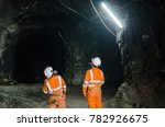 two miners observing the cavern | Shutterstock . vector #782926675