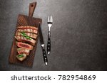 beef steak on cutting board... | Shutterstock . vector #782954869