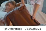 beautician doing massage with... | Shutterstock . vector #783025321