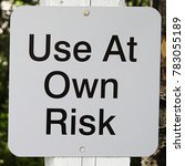 Small photo of Closeup of a use at own risk sign.