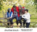 young friends sitting on fence | Shutterstock . vector #78305557
