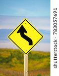 Small photo of Closeup of a curvy road ahead sign.