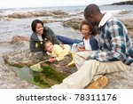 Young Family With Fishing Net...
