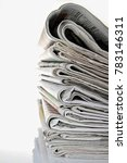 news paper sitting on a table   Shutterstock . vector #783146311