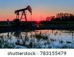 at sunset  oil pumps pour oil... | Shutterstock . vector #783155479