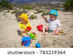 twins playing in the sand on...   Shutterstock . vector #783219364