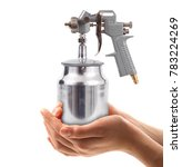 Small photo of isolated airbrush on white background held in hand