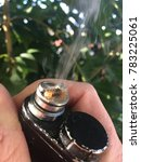 Small photo of ecigarette closeup on rebuildable bottom feeder atomizer