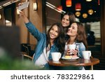 women meeting in cafe. friends... | Shutterstock . vector #783229861