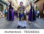 Small photo of Badajoz Spain friday. april 14. 2017. altar boy in Holy Friday. Procession of Holy Week in Badajoz.