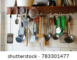 mix of kitchen tools hanging on ... | Shutterstock . vector #783301477