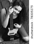 Woman with bass guitar, B&W - stock photo