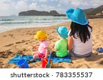 mother with twins on the beach... | Shutterstock . vector #783355537